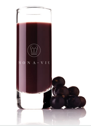 A glass of MonVie juice with Acai Berries